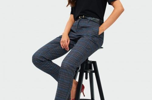 modna kobieta w eleganckich spodniach